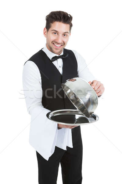 Butler Lifting Cloche From Serving Tray Stock photo © AndreyPopov