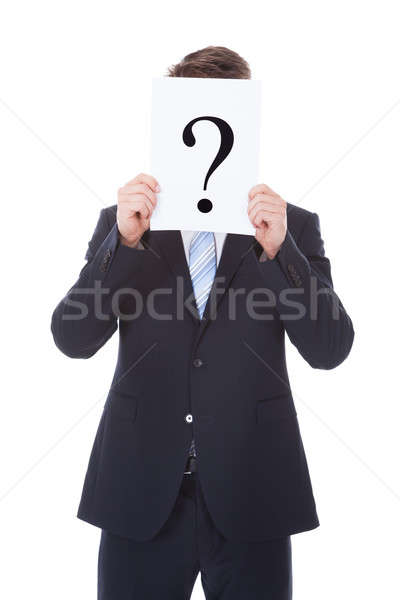 Businessman Holding Question Mark Sign In Front Of Face Stock photo © AndreyPopov
