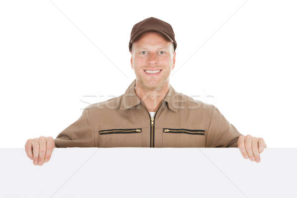 Smiling Manual Worker With Billboard Stock photo © AndreyPopov