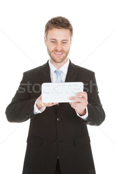 Happy Businessman Using Digital Tablet Stock photo © AndreyPopov