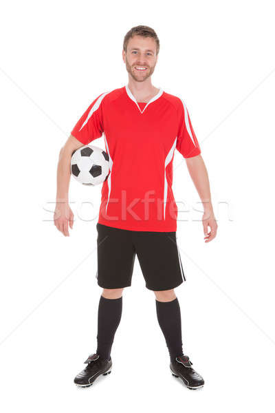 Soccer Player Holding Football Stock photo © AndreyPopov