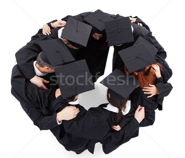 Graduate students standing in circle Stock photo © AndreyPopov