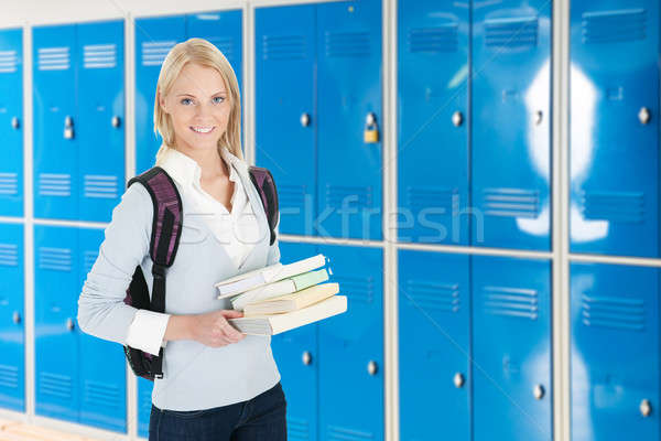 Young Female College Student With Stack Of Book Stock photo © AndreyPopov