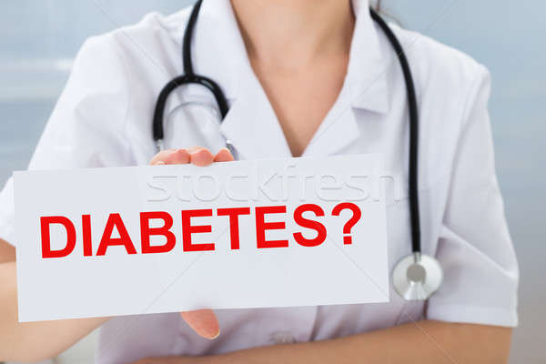 Doctor Holding Placard With Diabetes Text Stock photo © AndreyPopov