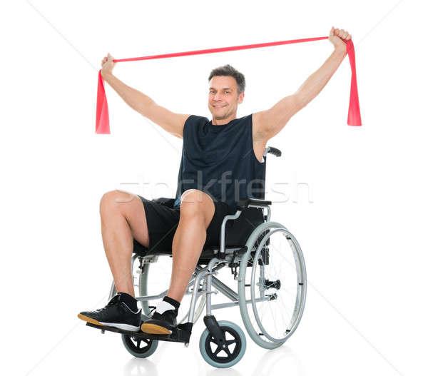 Disabili uomo sedia a rotelle resistenza band Foto d'archivio © AndreyPopov