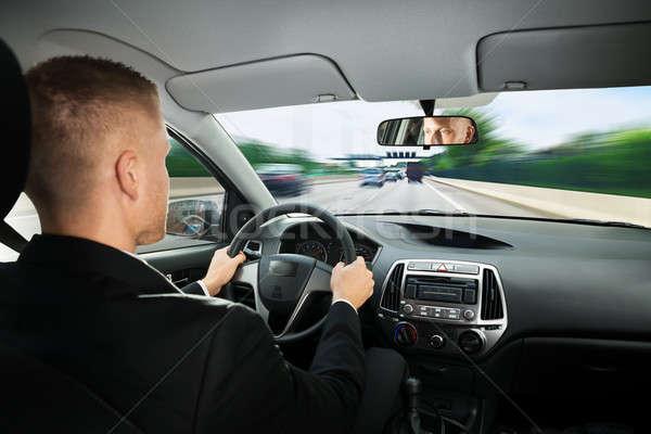 Stockfoto: Zakenman · rijden · auto · achteraanzicht · jonge · man