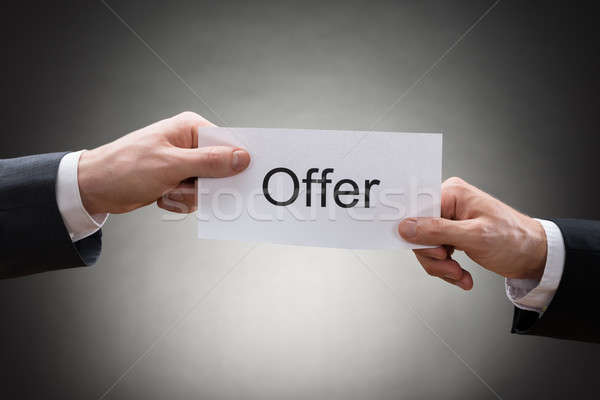 Close-up Of Two Hand's Holding Paper With Text Offer Stock photo © AndreyPopov