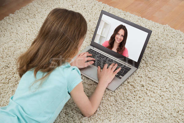 Girl Video Chatting On Laptop Stock photo © AndreyPopov