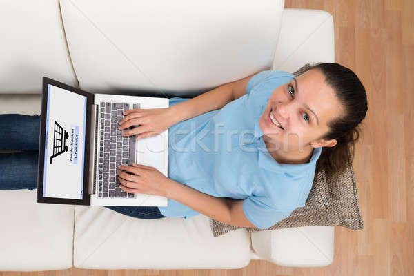 Woman On Sofa Shopping Online With Laptop Stock photo © AndreyPopov