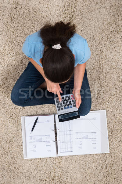 Woman Calculating Invoices With Calculator Stock photo © AndreyPopov