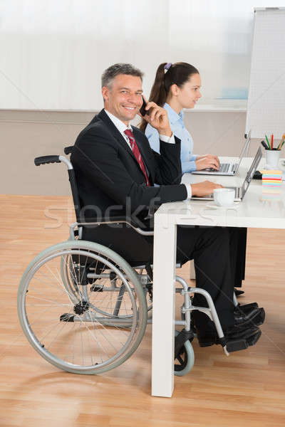 Disabled Businessman And Businesswoman In Conference Room Stock photo © AndreyPopov