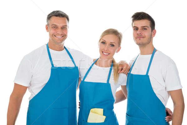 Niebieski fartuch grupy szczęśliwy biały Zdjęcia stock © AndreyPopov