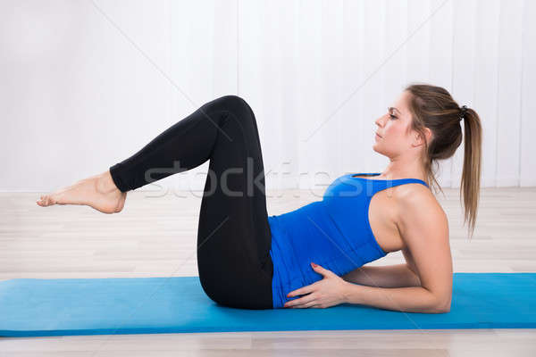 Young Female Doing Workout Stock photo © AndreyPopov