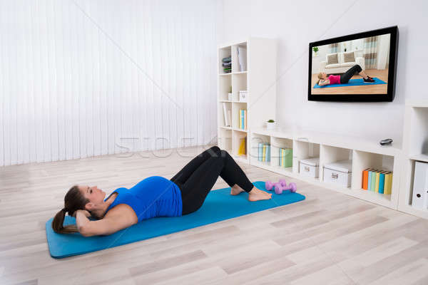 Stock photo: Pregnant Female Doing Workout By Lying On Exercise Mat