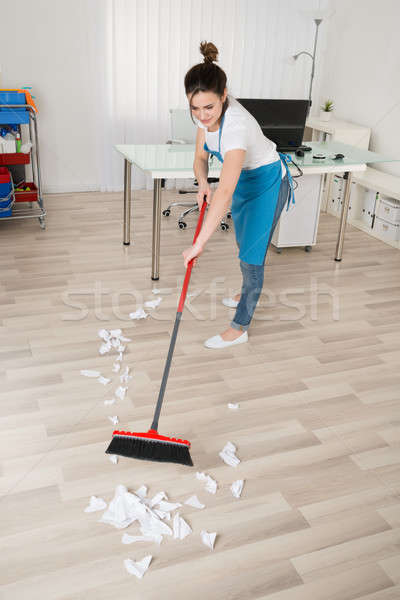 Female Janitor Sweeping Hardwood Floor Stock photo © AndreyPopov