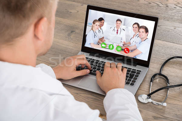 Doctor Having Video Conference On Laptop Stock photo © AndreyPopov