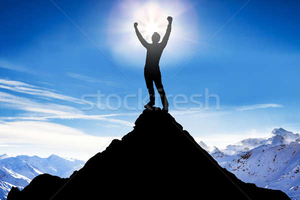 Silhouette Of A Man After Succeeded Climbing Stock photo © AndreyPopov