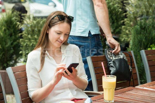 Tolvaj lop pénztárca nő férfi fiatal nő Stock fotó © AndreyPopov