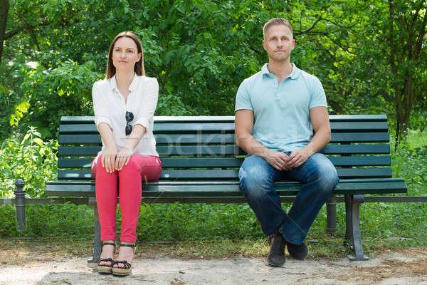 Shy uomo donna seduta panchina giovane Foto d'archivio © AndreyPopov