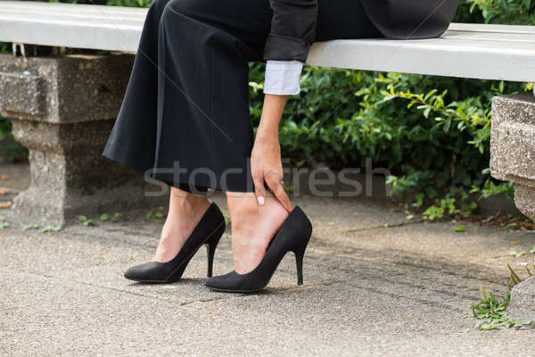 Businesswoman's Hand Removing High Heels Stock photo © AndreyPopov