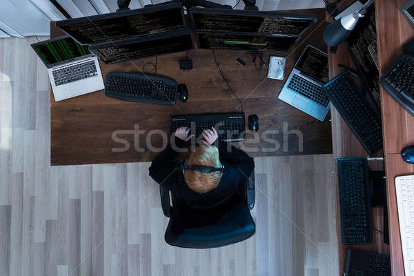 Erkek çalışma çoklu bilgisayarlar görmek Stok fotoğraf © AndreyPopov