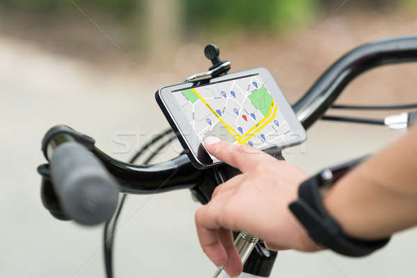 Doigt pointant GPS navigation Photo stock © AndreyPopov