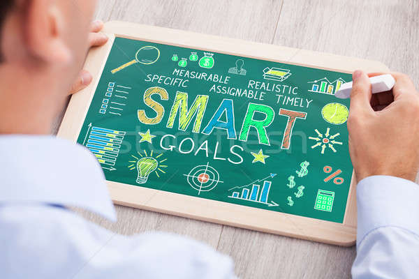 Businessperson Drawing Smart Goals Concept On Slate Stock photo © AndreyPopov