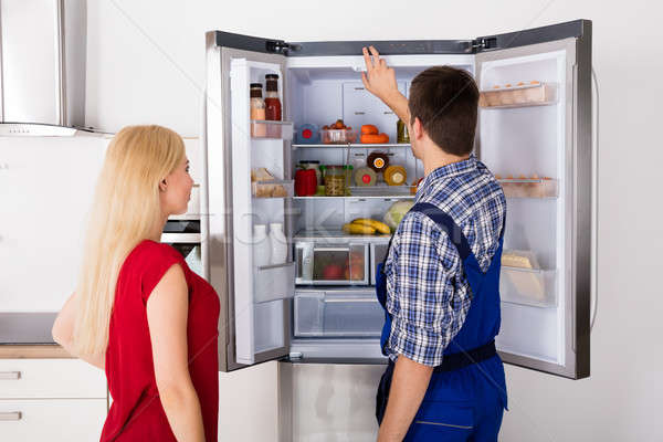 Male Worker Repairing Refrigerator In Kitchen Room Stock photo © AndreyPopov