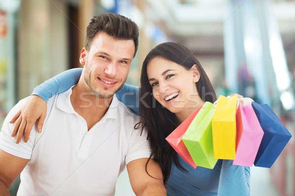 Gülen çift portre renkli alışveriş çantası Stok fotoğraf © AndreyPopov