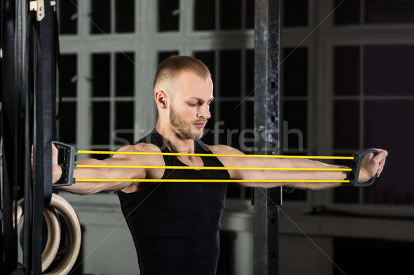 An Athlete Man Working With Stretch Band Stock photo © AndreyPopov