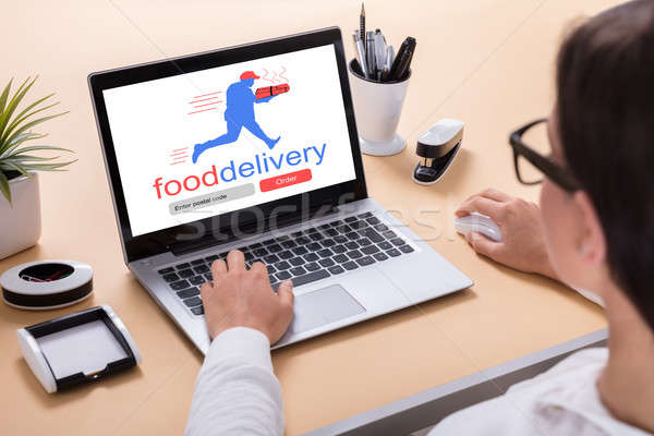 Businesswoman Delivering Food Online Stock photo © AndreyPopov