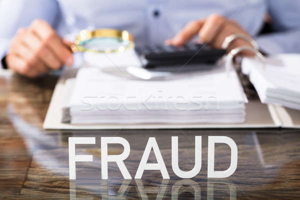 Fraud Text On Office Desk Stock photo © AndreyPopov