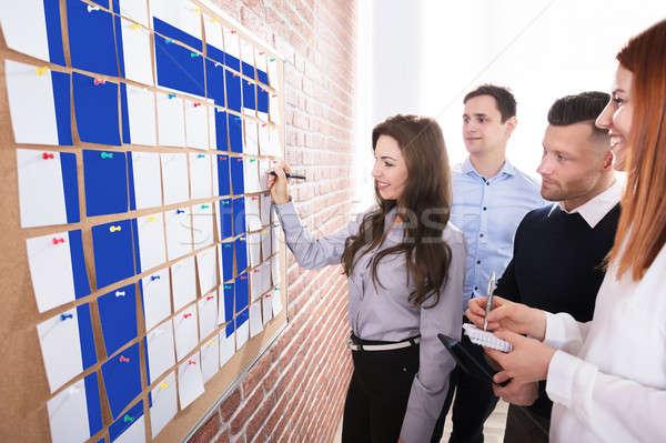 üzletemberek tervez informatika csoport tapadó jegyzetek Stock fotó © AndreyPopov