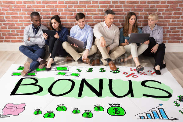 Stock photo: People Looking At Bonus And Employee Compensation Concept