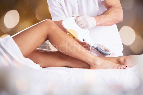 Woman Getting Laser Treatment On Leg Stock photo © AndreyPopov