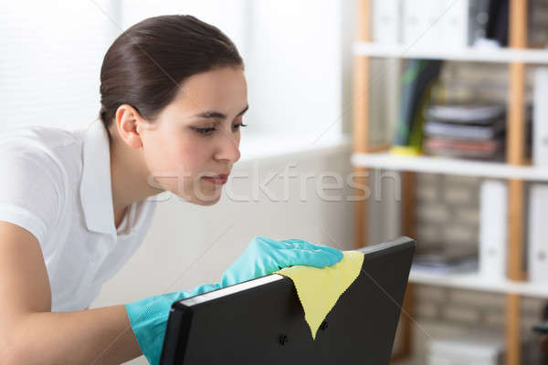 Woman Cleaning Desktop With Rag Stock photo © AndreyPopov