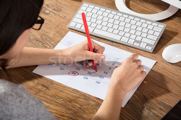 Close-up Of A Woman Circling The Date On Calendar Stock photo © AndreyPopov
