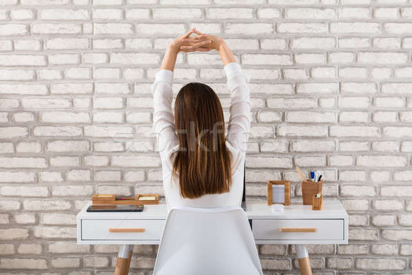 Rear View Of A Businesswoman Stretching Her Arms Stock photo © AndreyPopov