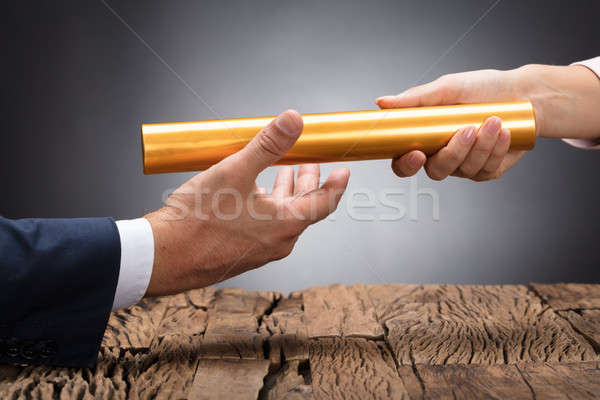 Close-up Of A Businessperson Passing Baton Stock photo © AndreyPopov