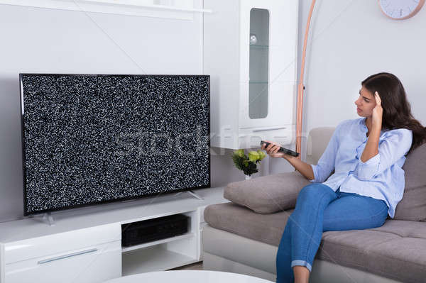 Woman Getting Frustrated With Glitch TV Screen Stock photo © AndreyPopov