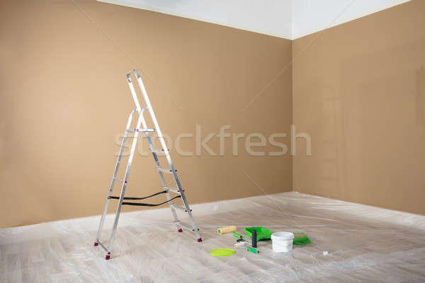 Painted Room With Ladder And Painting Equipments Stock photo © AndreyPopov