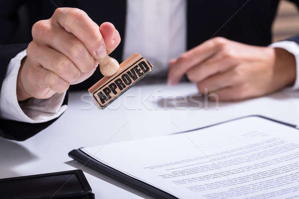 Person Hands Using Stamper On Document With The Text Approved Stock photo © AndreyPopov