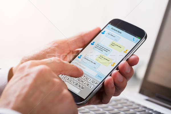Businessperson Sending Text Message From Mobile Phone Stock photo © AndreyPopov