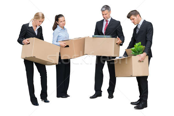 Unhappy Businesspeople Standing With Cardboard Boxes Stock photo © AndreyPopov