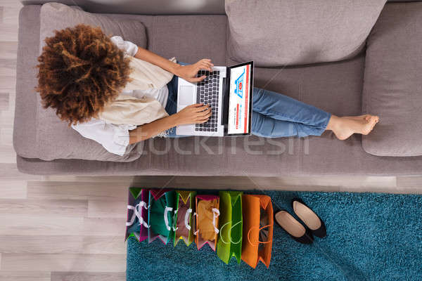 Happy Young Woman Using Laptop Stock photo © AndreyPopov