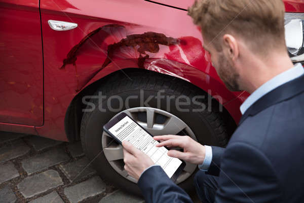 Man Looking At Digital Tablet Near Car Stock photo © AndreyPopov
