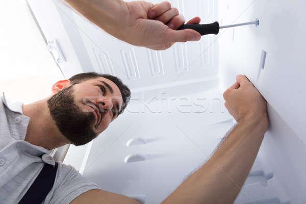 Electricista refrigerador cocina primer plano masculina Foto stock © AndreyPopov