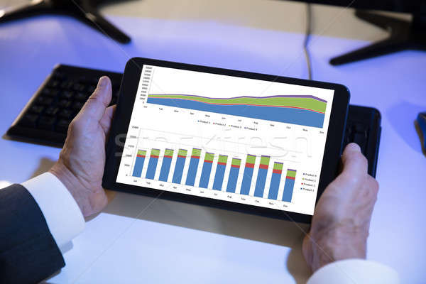 Stock photo: Businessperson Looking At Financial Graph On Digital Tablet