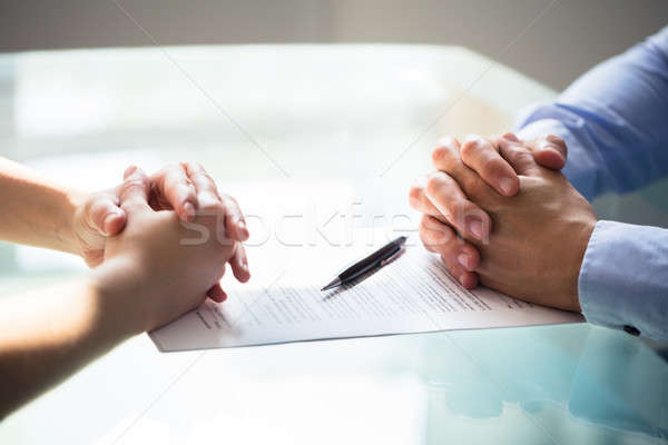 Two Businesspeople Hand With Document Stock photo © AndreyPopov