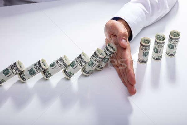 Persona caer billetes escritorio Foto stock © AndreyPopov